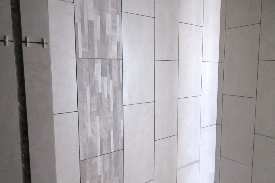 Wall tiling work for toilet at level 10